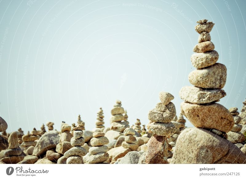 another stack of stones Leisure and hobbies Playing Landscape Sky Summer Beautiful weather Stone Bright Blue Brown Attentive Serene Patient Contentment Planning
