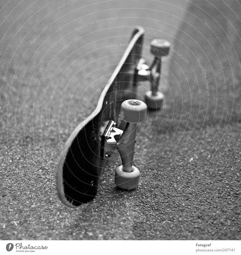 skateboard Skateboard Street Lanes & trails Black Skateboarding Coil Axle Asphalt Aluminium Black & white photo Exterior shot Deserted Shallow depth of field