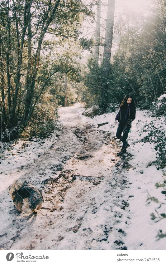 Girl waiting at the side of the snowy mountain road looking down Woman Nature Vacation & Travel Beautiful Green Landscape White Tree Calm Forest Winter Mountain