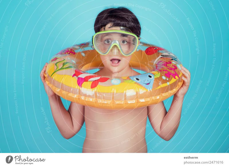 happy child smiling with float ring Lifestyle Joy Swimming pool Vacation & Travel Trip Summer Sun Beach Ocean Sports Dive Human being Child Toddler Infancy 1