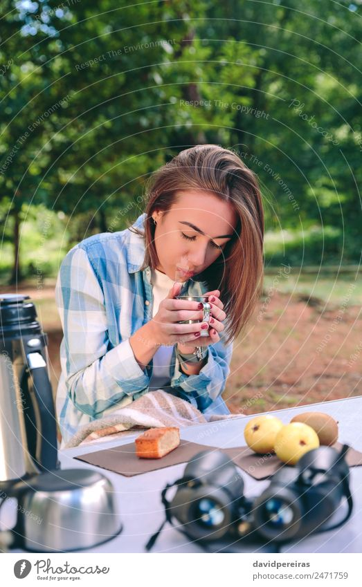Woman holding cup of hot coffee sitting under blanket Fruit Breakfast Coffee Lifestyle Relaxation Leisure and hobbies Vacation & Travel Trip Adventure Camping