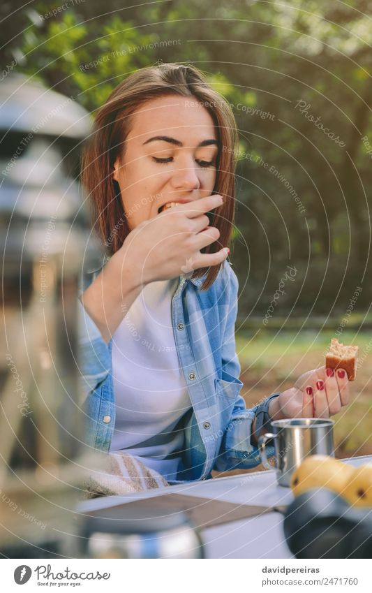 Woman eating cake in breakfast into the forest Fruit Eating Breakfast Coffee Lifestyle Relaxation Leisure and hobbies Vacation & Travel Trip Adventure Camping