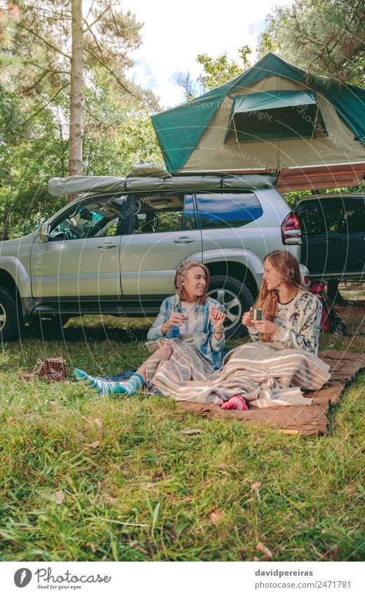 Women sitting under blanket with 4x4 on background Woman Nature Vacation & Travel Summer Relaxation Joy Forest Mountain Adults Lifestyle Autumn Grass Happy