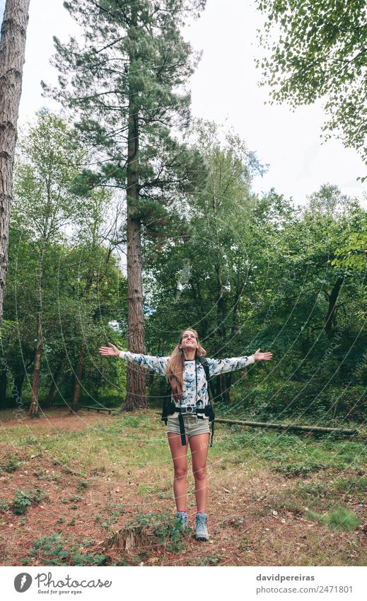 Hiker woman with backpack raising her arms Woman Human being Sky Nature Vacation & Travel Summer Landscape Tree Relaxation Joy Forest Mountain Adults Lifestyle