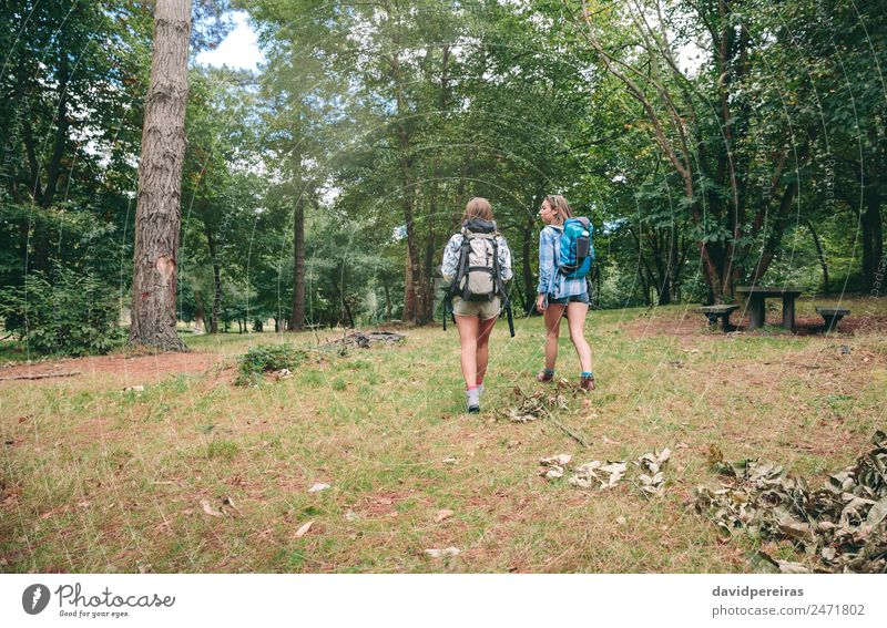 Two women friends with backpacks walking Lifestyle Joy Happy Leisure and hobbies Vacation & Travel Trip Adventure Camping Summer Mountain Hiking Sports