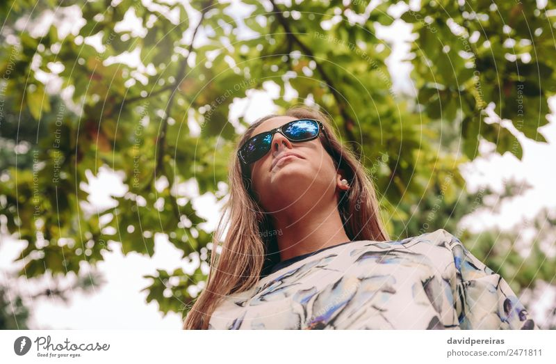 Woman with sunglasses standing over nature background Lifestyle Joy Happy Relaxation Leisure and hobbies Trip Freedom Summer Mountain Success Human being Adults