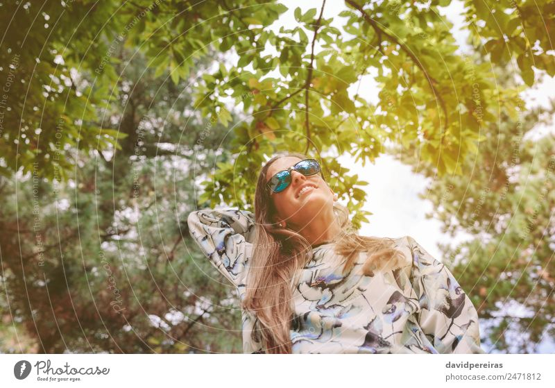 Woman with sunglasses touching over nature background Human being Sky Nature Summer Blue Green Tree Relaxation Joy Forest Mountain Adults Lifestyle Autumn