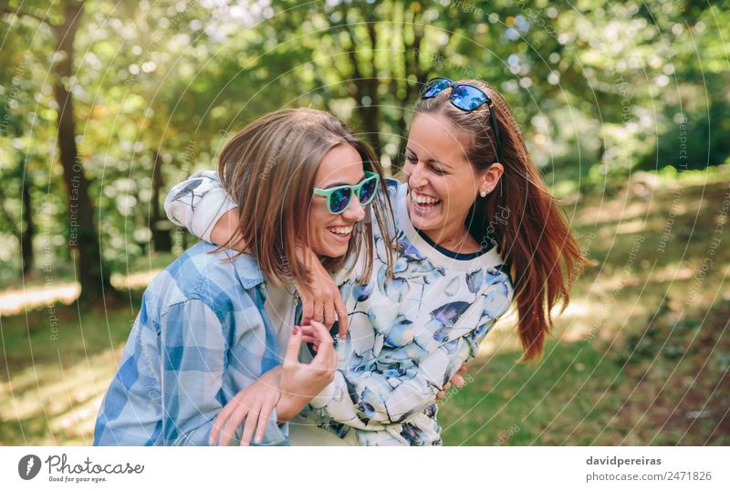 Happy women embracing and laughing over nature background Woman Human being Nature Youth (Young adults) Summer Beautiful Tree Joy Adults Lifestyle Autumn Love