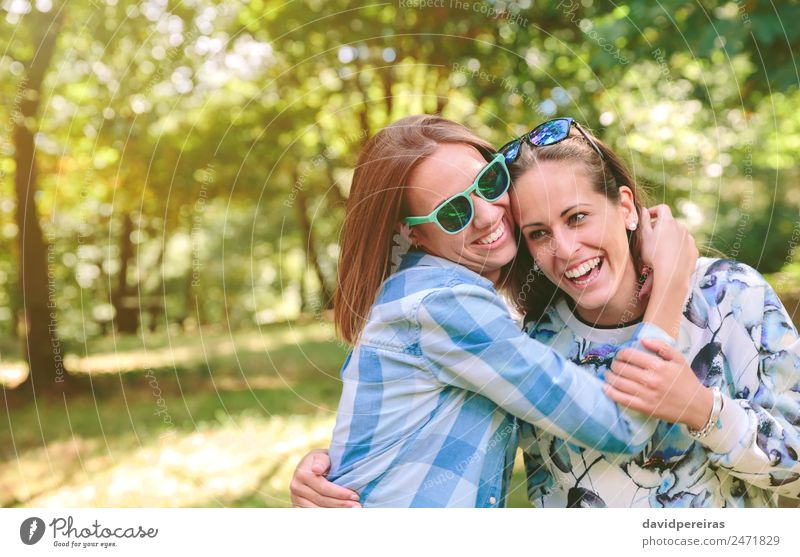 Happy women embracing and having fun over nature background Lifestyle Joy Beautiful Leisure and hobbies Summer Human being Woman Adults Friendship Couple