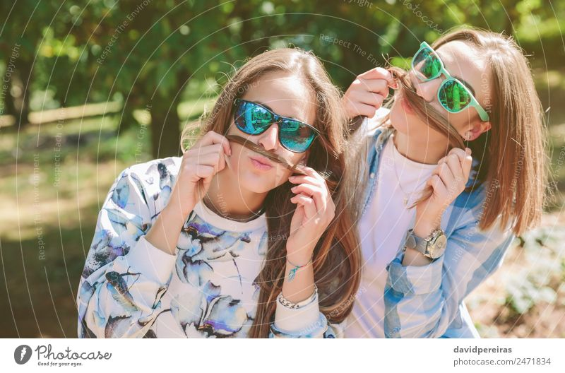 Women having fun doing moustaches with hair Lifestyle Joy Happy Beautiful Leisure and hobbies Summer Mountain Human being Woman Adults Friendship Couple Nature