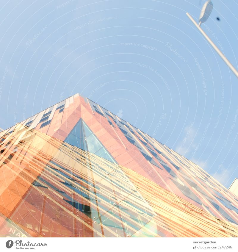 life is very complex. Construction site Sky Beautiful weather Town High-rise Manmade structures Building Architecture Facade Window Bright Blue Yellow Orange