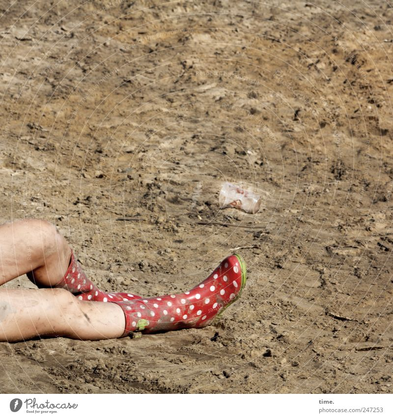logged off temporarily Skin Feminine Legs Feet Knee 1 Human being Earth Sand Rubber boots Lie Dirty Exhaustion Spotted Untidy Fatigue Colour photo Exterior shot