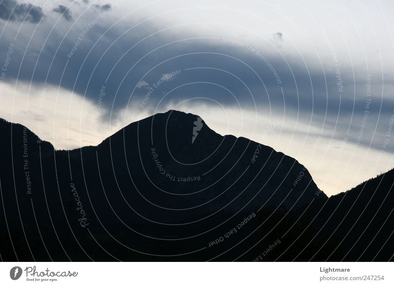 Sky Nature Blue Vacation & Travel Far-off places Mountain Emotions Landscape Gray Stone Moody Air Earth Rock Elements Hill