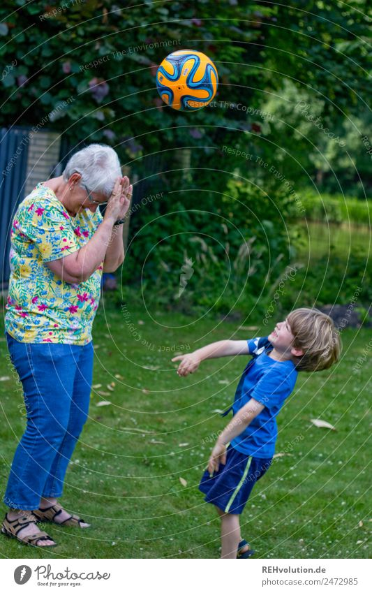 boy throws a ball at grandma Leisure and hobbies Children's game Ball sports Human being Masculine Feminine Boy (child) Female senior Woman Grandmother