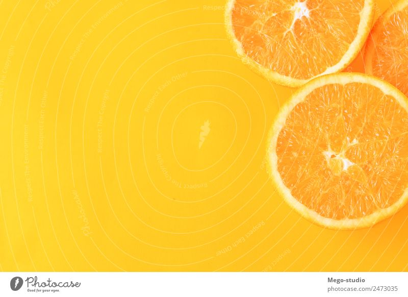 orange slices on yellow background. Fruit Dessert Eating Vegetarian diet Diet Juice Exotic Nature Fresh Natural Juicy Yellow White Colour isolated citrus Slice