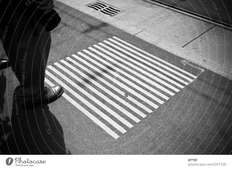 Street Line Footwear Wait Signs and labeling Concrete Stand Asphalt Arrow Railroad tracks Sidewalk Pants Square Pedestrian Patient Exterior shot