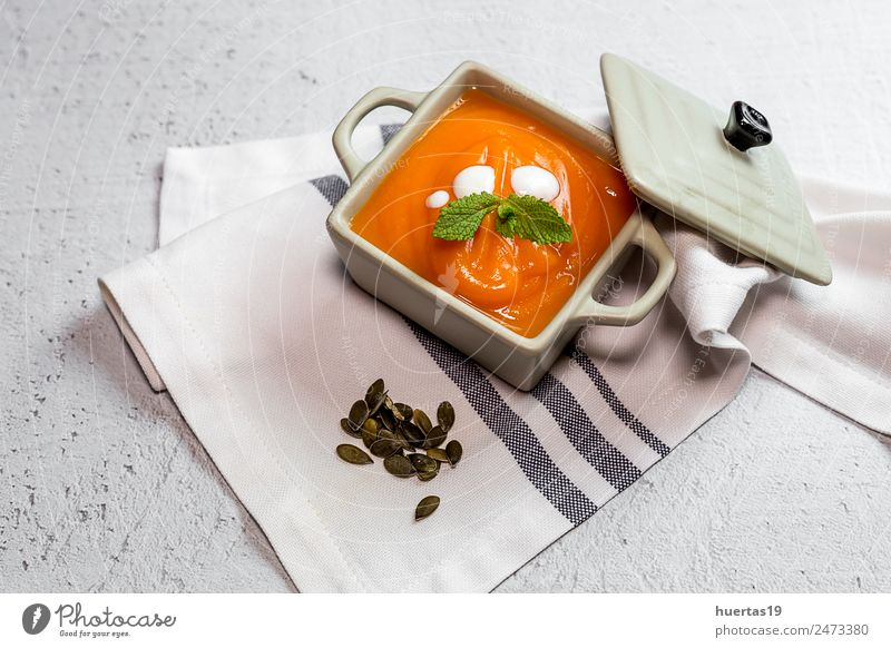 Cream of pumpkin in bowl. Food Vegetable Soup Stew Dinner Vegetarian diet Diet Plate Bowl Spoon Lifestyle Beautiful Healthy Healthy Eating Autumn Yellow