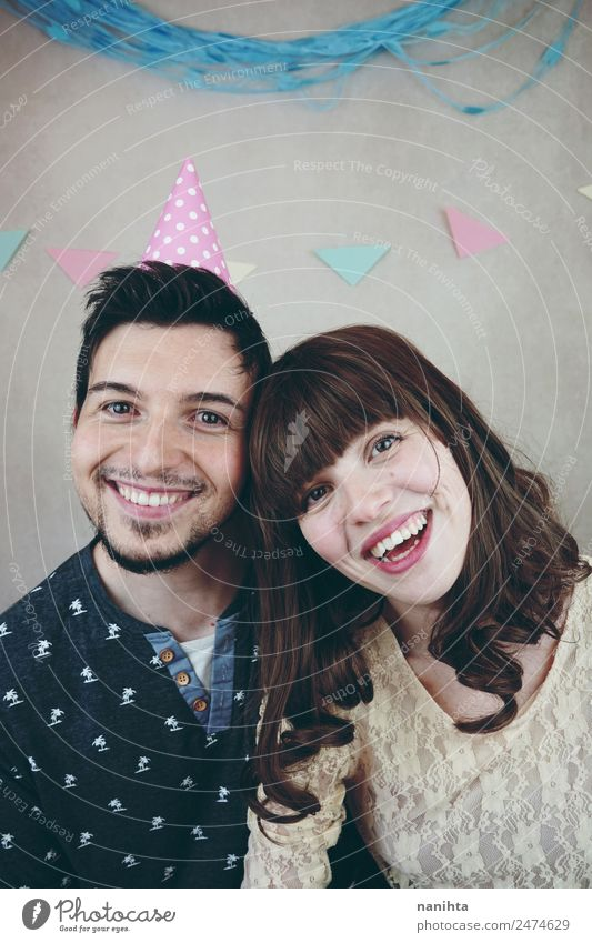Young happy couple celebrating a birthday party Lifestyle Joy Wellness Well-being Party Event Feasts & Celebrations Birthday Human being Masculine Feminine