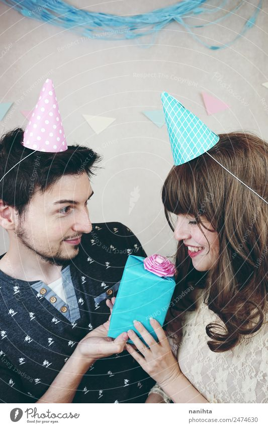 Young couple celebrating a birthday Human being Youth (Young adults) Young woman Beautiful Young man 18 - 30 years Adults Lifestyle Love Funny Feminine