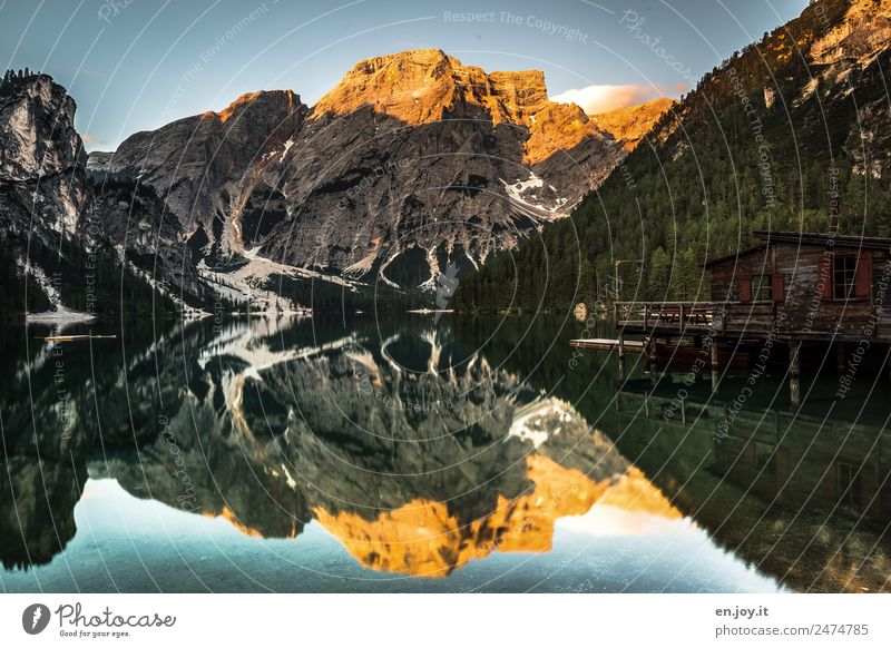 The Braies Wildsee with reflection of the mountains, the boathouse with alpenglow Vacation & Travel Tourism Trip Summer Summer vacation Mountain Nature