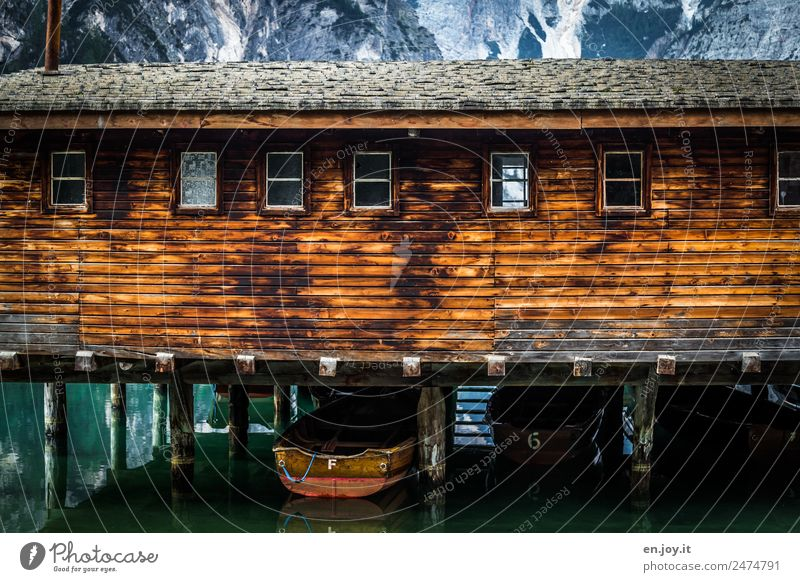 stilted Leisure and hobbies Vacation & Travel Trip Mountain Alps Lake Pragser Wildsee Lake Hut Boathouse Facade Window Rowboat Wood Adventure Relaxation