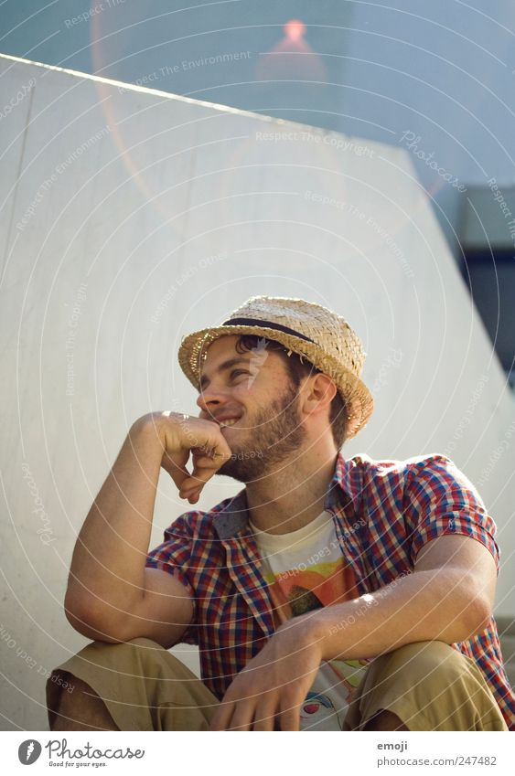 hang out Masculine Young man Youth (Young adults) 1 Human being 18 - 30 years Adults Summer Hat Straw hat Easygoing Relaxation Smiling Laughter Lens flare