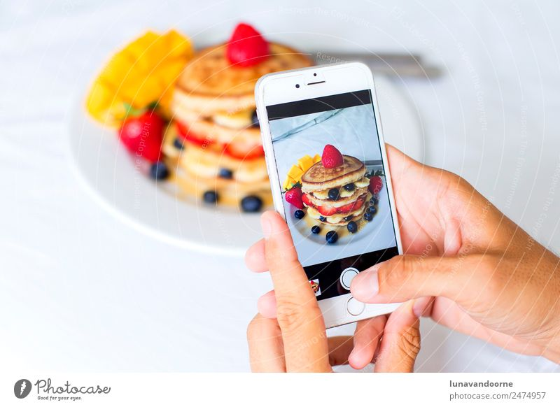 Closeup of hands taking a picture of breakfast with a smartphone Dessert Breakfast Lunch Plate Table Telephone Cellphone Camera Technology Man Adults Hand