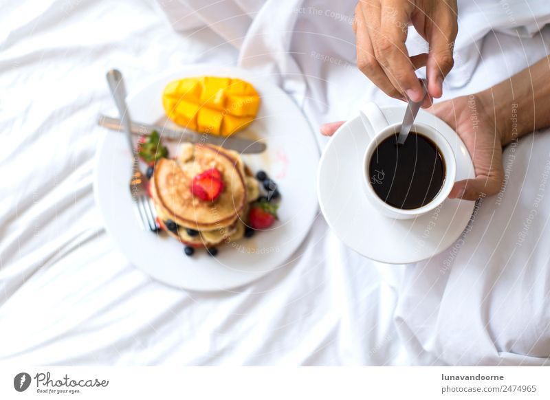 Hotcakes with fruit and coffee in bed Dessert Breakfast Lunch Coffee Plate Man Adults Hand Delicious White Berries blogger colorful Dish food healthy Home-made
