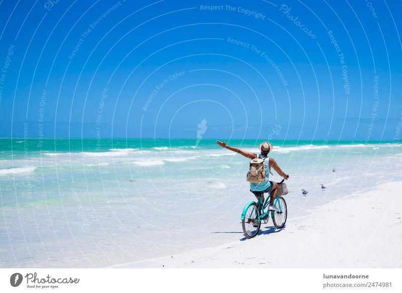 Man riding a bike on the sea shore. Lifestyle Joy Relaxation Vacation & Travel Freedom Summer Sun Beach Sports Cycling Homosexual Adults 1 Human being