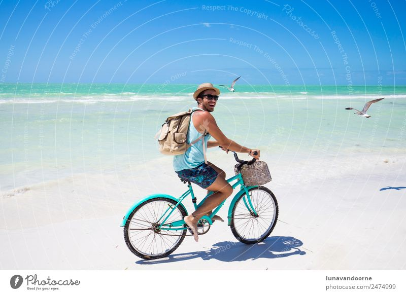 Man riding a bike on the sea shore Human being Sky Vacation & Travel Youth (Young adults) Summer Blue Sun Ocean Relaxation Joy Beach 18 - 30 years Adults
