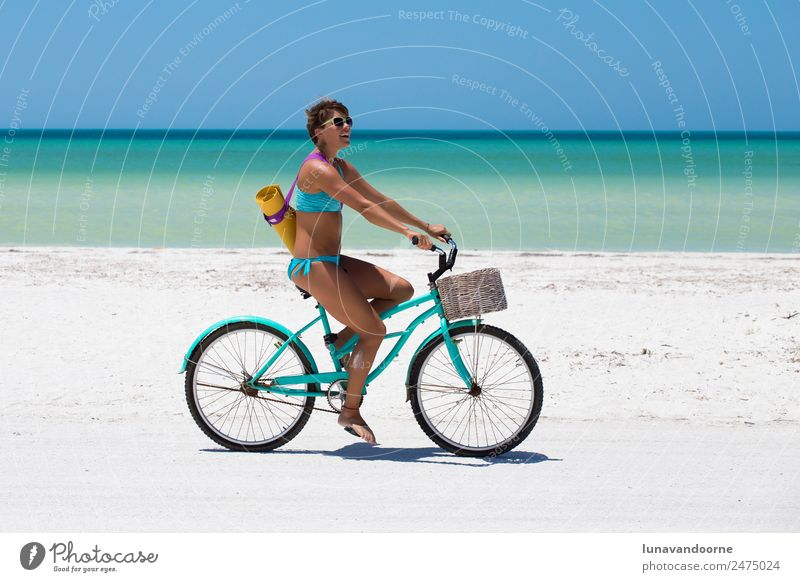 Woman biking on the beach with a yoga mat Lifestyle Joy Leisure and hobbies Freedom Cycling tour Summer Beach Sports Yoga 1 Human being 18 - 30 years