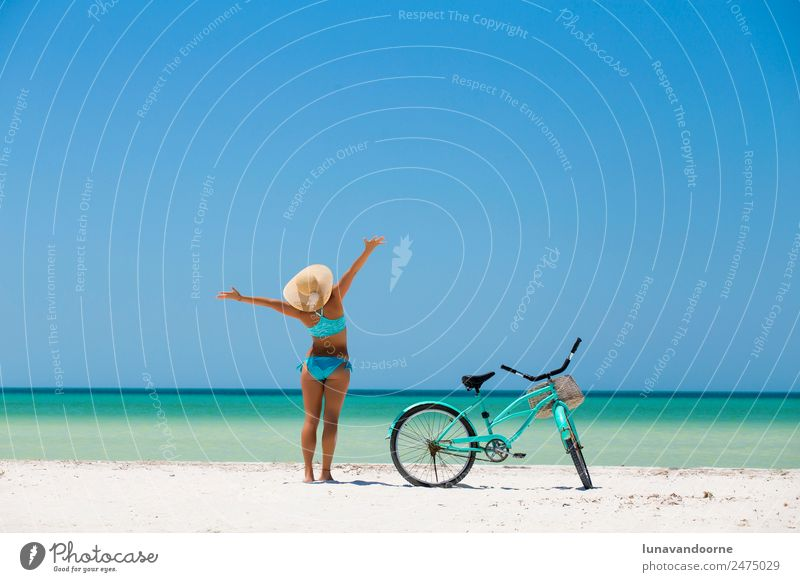 Woman and a bike on the beach Lifestyle Joy Beautiful Leisure and hobbies Vacation & Travel Freedom Summer Beach Cycling Human being Adults Arm Nature Sand Sky