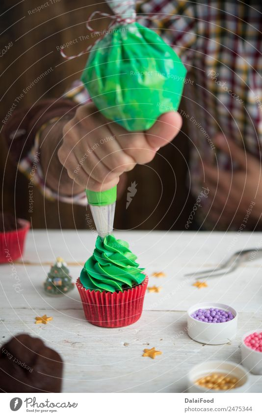 Making cupcake for christmas time Dessert Winter Decoration Feasts & Celebrations Christmas & Advent Tree Bright Green White Colour background Baking colorful