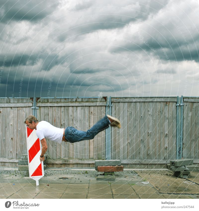 storm warning Human being Masculine Man Adults 1 30 - 45 years Sky Clouds Storm clouds Bad weather Wind Gale T-shirt Jeans Signs and labeling Signage