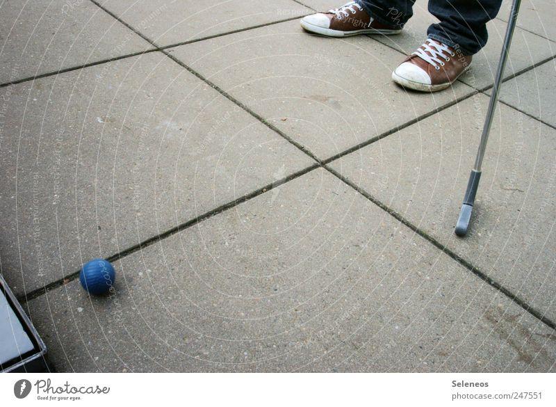 Human being Playing Feet Footwear Concrete Leisure and hobbies Ball Golf club Golf ball Mini golf