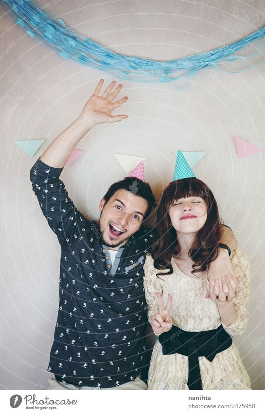 Young happy couple enjoying a birthday party Human being Youth (Young adults) Man Young woman Joy 18 - 30 years Adults Lifestyle Love Feminine