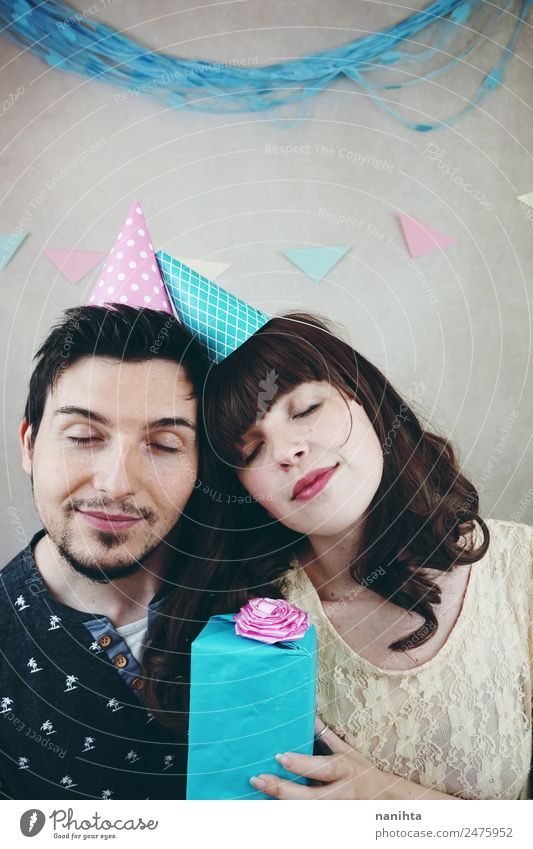 Young happy couple in a birthday party Woman Human being Youth (Young adults) Man Young woman Beautiful Young man Joy Lifestyle Adults Love Feminine