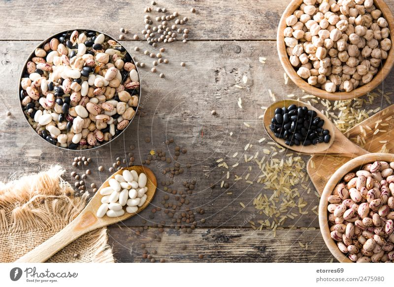 Uncooked assorted legumes in wooden bowl Food Healthy Eating Food photograph Grain Nutrition Organic produce Vegetarian diet Diet Bowl Spoon Nature Brown White