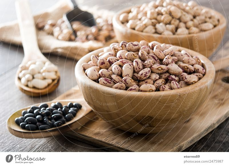 Uncooked assorted legumes in bowls Food Grain Nutrition Eating Organic produce Vegetarian diet Diet Natural Brown Black White Legume Mixed Beans Chickpeas