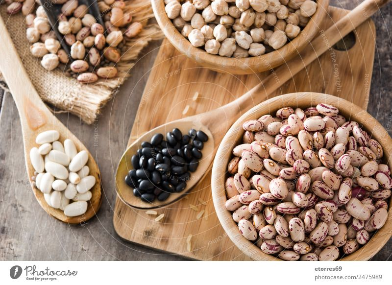 Uncooked assorted legumes in wood Food Grain Nutrition Organic produce Vegetarian diet Diet Bowl Spoon Natural Brown Legume Beans Chickpeas Food photograph
