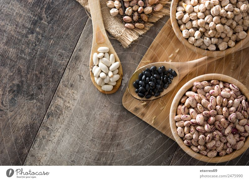 Uncooked assorted legumes Food Grain Organic produce Vegetarian diet Diet Bowl Spoon Natural Brown Legume Food photograph Nutrition Beans Chickpeas Black Wood