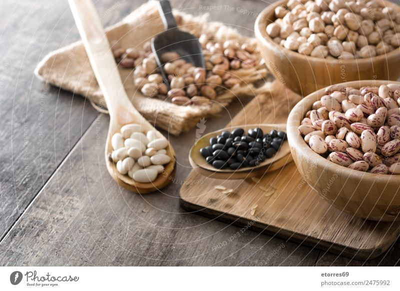 Uncooked assorted legumes in wooden bowl Food Grain Nutrition Eating Organic produce Vegetarian diet Diet Bowl Spoon Natural Brown Legume Mix Beans Chickpeas