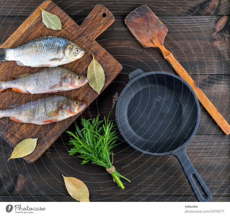 Purified river fish from the scales Fish Seafood Herbs and spices Nutrition Dinner Diet Pan Table Animal River Wood Fresh Above Retro Brown Black Perches