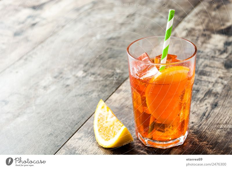Aperol spritz cocktail Summer Cold Orange Ice Fresh Glass Sweet Beverage Summer vacation Good Refreshment Alcoholic drinks Wooden table Cold drink Cocktail