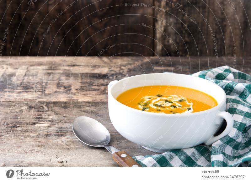 Pumpkin soup in white bowl on wood Food Vegetable Soup Stew Nutrition Eating Organic produce Vegetarian diet Diet Hot drink Bowl Spoon Thanksgiving Hallowe'en