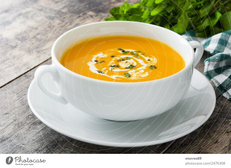 Pumpkin soup in white bowl Food Vegetable Soup Stew Nutrition Organic produce Vegetarian diet Diet Hot drink Bowl Spoon Hallowe'en Natural Green Orange White