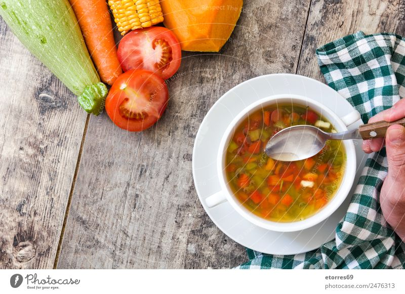 Vegetable soup in bowl on wooden table Food Soup Stew Herbs and spices Nutrition Eating Dinner Organic produce Vegetarian diet Diet Beverage Cold drink Bowl