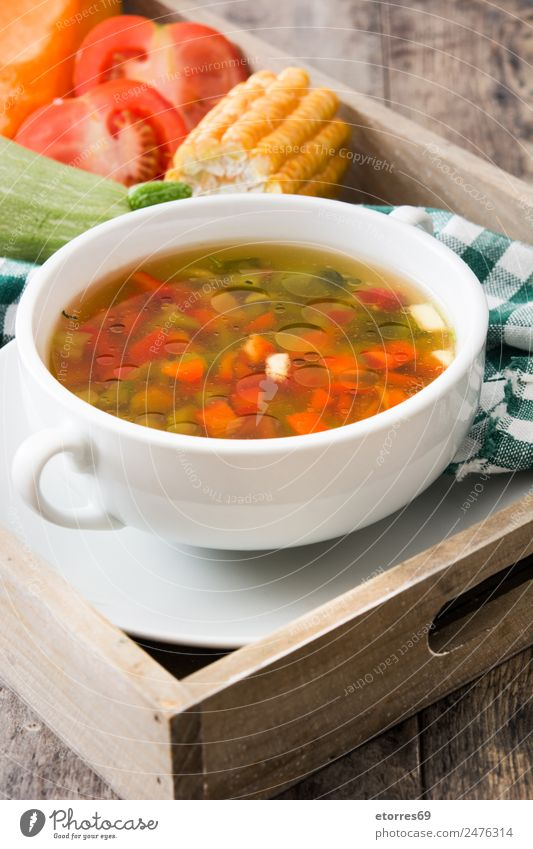 Vegetable soup in bowl on wooden table Food Soup Stew Herbs and spices Nutrition Eating Dinner Organic produce Vegetarian diet Diet Cold drink Bowl Spoon Wood