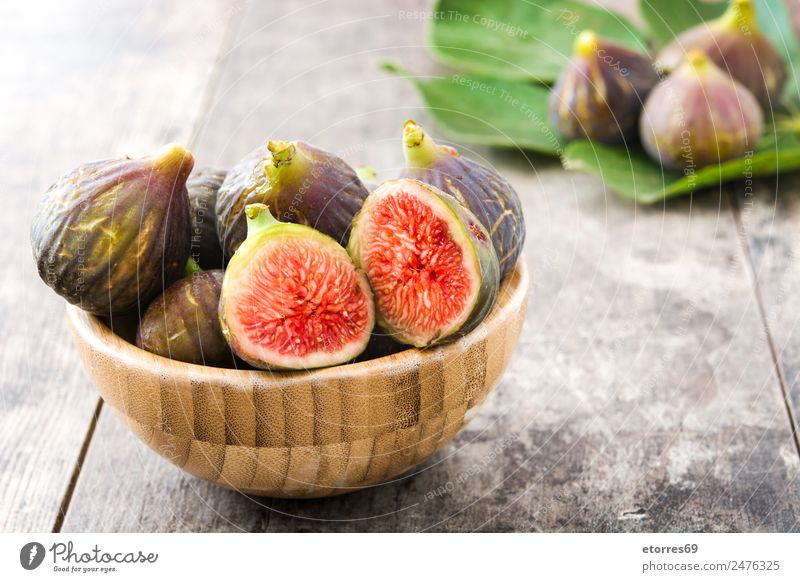 Fresh figs on wooden background Fig Fruit Food Healthy Eating Food photograph antioxidant Raw Sweet Tropical Vitamin White Wood