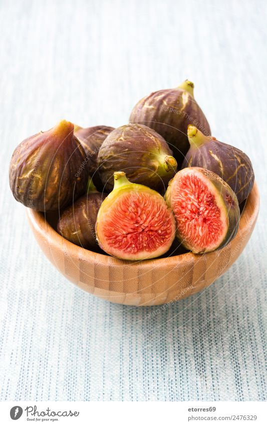 Fresh figs in bowl on blue background Fig Fruit Food Healthy Eating Food photograph antioxidant Raw Sweet Tropical Vitamin Bowl Blue